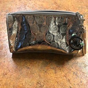 Michael Kors metallic silver makeup or wallet